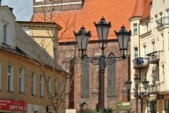 Chojnice, ul. Kościuszki z widokiem na Bazylikę Mniejszą  p.w. Ścięcia św. Jana Chrzciciela